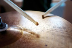Closeup of drumsticks and the drum set. Drummer equipment. Drum and cymbal. Music background. Drums conceptual image.