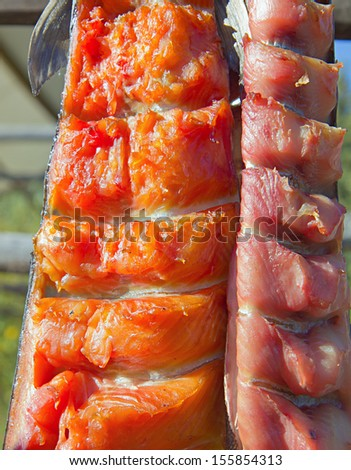 Closeup of Drying Salmon on Sticks by Native Americans in Alaska