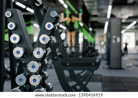 Closeup of dumbbells in gym. Rack with different dumbbells in gym, closeup.