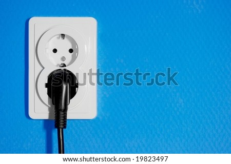 Closeup of electric outlets on blue wall