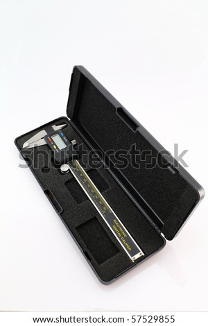 Closeup of electronic digital caliper in a cushioned case to protect the precision instrument.  Taken against a neutral (almost white) background.