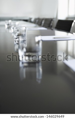 Closeup of empty glasses on conference table in office