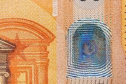 Closeup of 50 Euro banknote, design of new 50 Euro bills. European money fifty Euros. European Monetary Union. Hologram safety feature on paper money