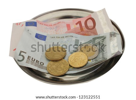 Closeup of European banknotes and coins on metal tray, white background.