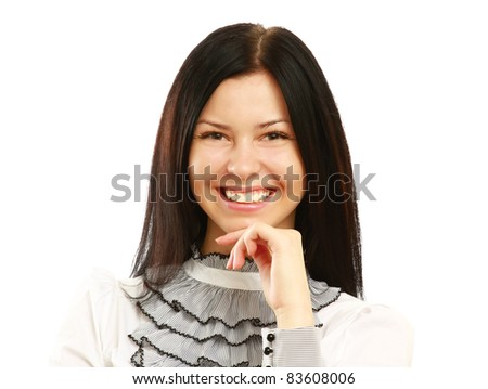 Closeup of executive smiling while resting chin on hand