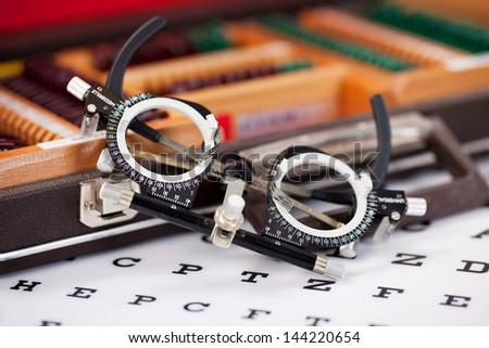 Closeup of eye examination glasses on Snellen chart