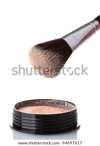 closeup of face powder and brush isolated on white