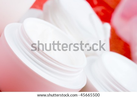 closeup of facial cream and cotton pads - cosmetics