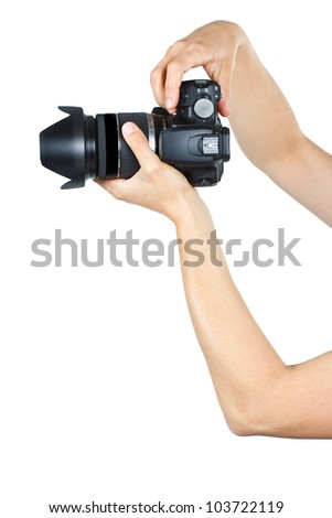 Closeup of female arms and hands holding a camera - isolated on white