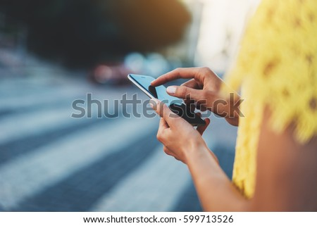 closeup of female hands using...