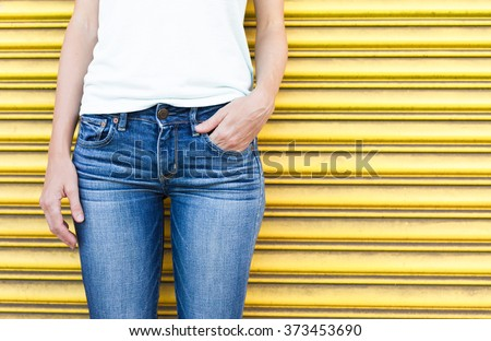 Closeup of female wearing jeans.