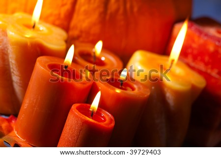 Closeup of festive aromatic candles burning merrily - fall theme