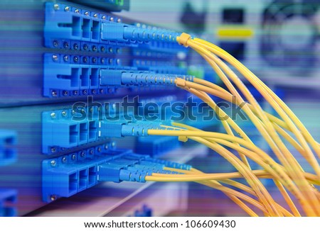 closeup of fiber optical network hub and cables