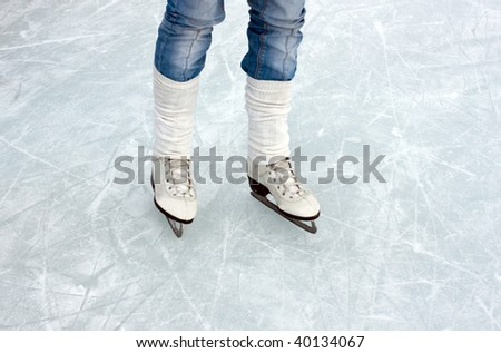 closeup of figure skating ice skates in action outdoors