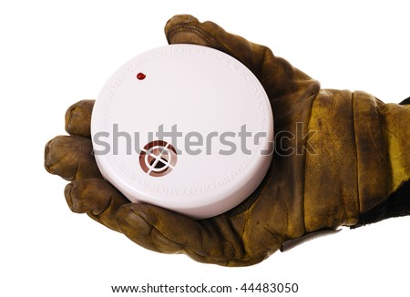 Closeup of firefighters hand holding fire alarm isolated on white