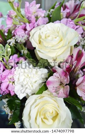 closeup of flowers roses and alstroemerias  #1474097798