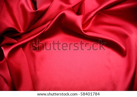 Closeup of folds in red silk fabric