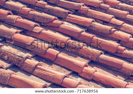 Closeup of fragment of old roof tiles texture in Italy #717638956