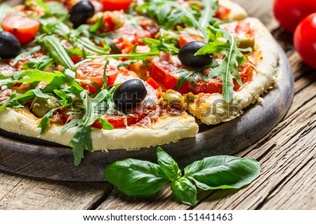 Closeup of fresh pizza with vegetables