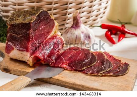 Closeup of fresh sliced prosciutto ham