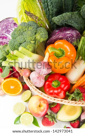Closeup of Fresh Vegetables and Fruits in Basket on White Background