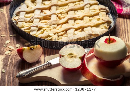 Closeup of freshly baked apple pie and apples