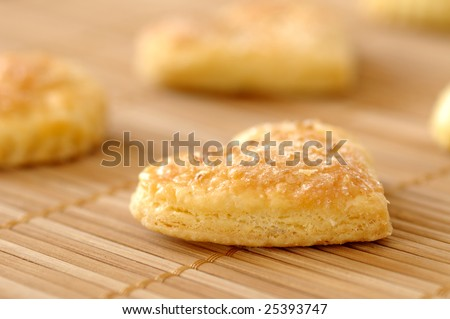 Closeup of freshly baked butter cookies in the shape of hearts