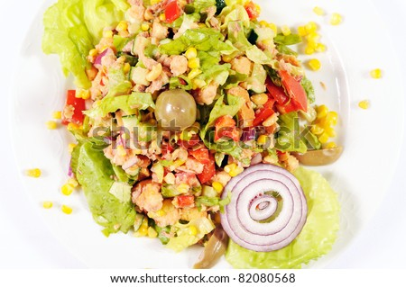 Closeup of freshly prepared vegetable salad with tuna fish