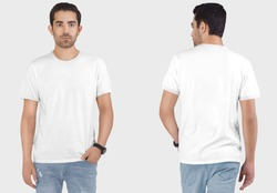 Closeup of front and rear look of male model wearing white plain ringer t shirt in blue denim jeans pant.