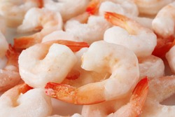 Closeup of frozen precooked shrimps.