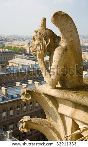 Closeup of gargoyle on the top of Notre-Dame de Paris