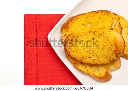 closeup of garlic bread against white background
