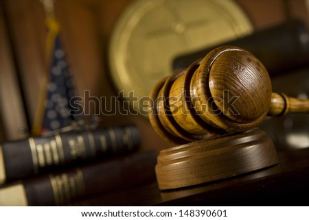 Closeup of gavel in court room - stock photo