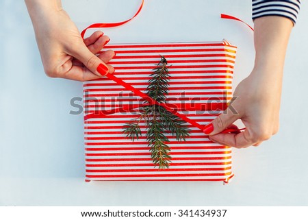 Closeup of gift wrapping. Woman packs gifts, step by step