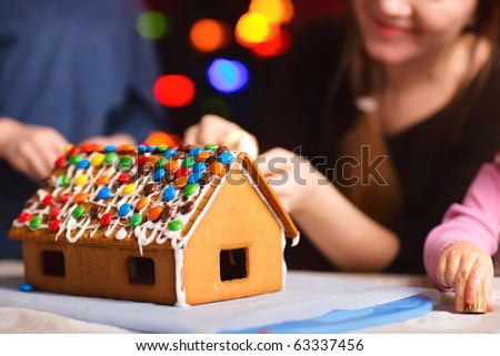 Closeup of gingerbread house decorated with colorful candies