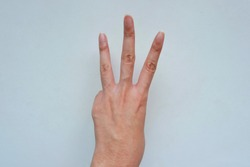 Closeup of girl left sign language meaning W, 6(six), 3(three) and hand turn inside-out isolated on a white background.