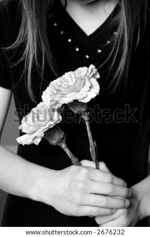 stock photo : Closeup of girl with long hair holding flowers in her hands