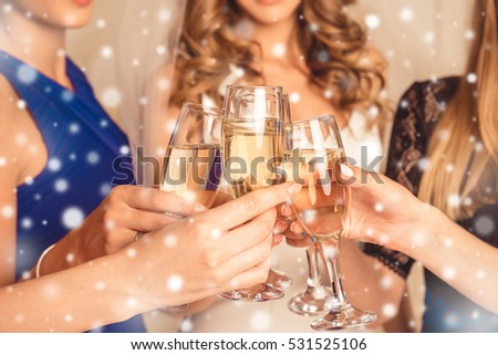 Closeup of girls celebrating new year party with shampagne #531525106