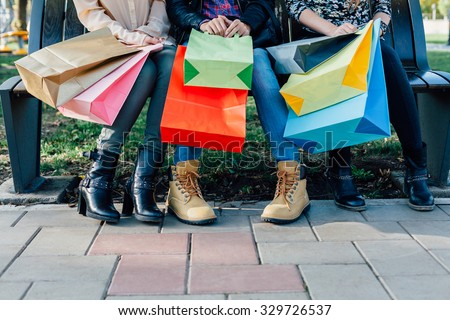 Closeup of girls with colorful shopping bags