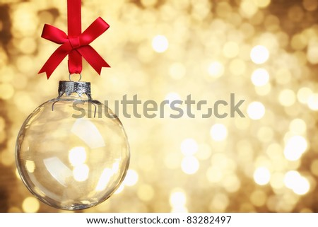 Closeup of glass Christmas ball on abstract light background.