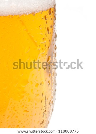 Closeup of Glass of Draught Beer on White Background