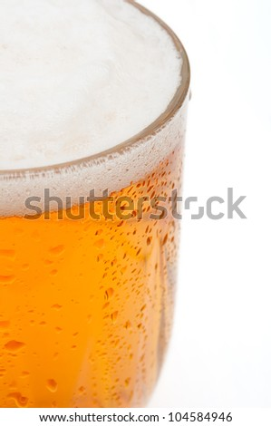 Closeup of Glass of Draught Beer on White Background - Shallow Depth of Field