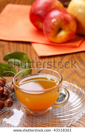 Closeup of glass of fresh pressed sweet cider and apples crop