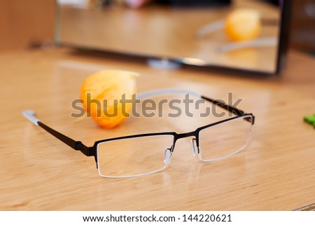 Closeup of glasses on wooden table