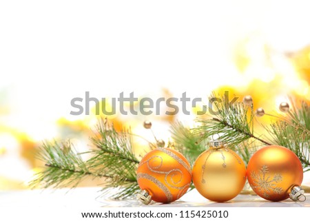Closeup of  golden Christmas balls on festive background.