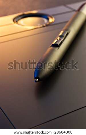 closeup of graphic tablet  with pen
