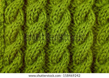 Closeup of green coiled rope cable knitting stitch