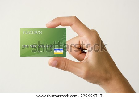 closeup of green credit card holded by hand. #229696717