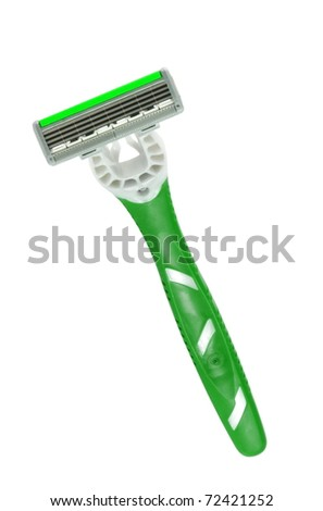 Closeup of green shaving blade on white surface