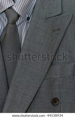 stock-photo-closeup-of-grey-male-suit-44538934.jpg